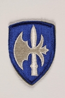 2004.749.17 front US Army 65th Infantry Division shoulder sleeve patch with a white halberd on a blue field  Click to enlarge