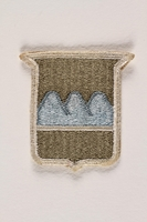 2004.749.18 front US Army 80th Infantry Division shoulder sleeve patch with three blue mountains  Click to enlarge