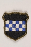 2004.749.19 front US Army 99th Infantry Division shoulder sleeve patch with a blue and white checkerboard  Click to enlarge