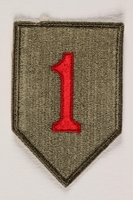 2004.749.20 front US Army 1st Infantry Division shoulder sleeve patch with a big red numeral one on a green field  Click to enlarge