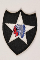 2004.749.21 front US Army 2nd Infantry Division shoulder sleeve patch with a Native American caricature on white star  Click to enlarge