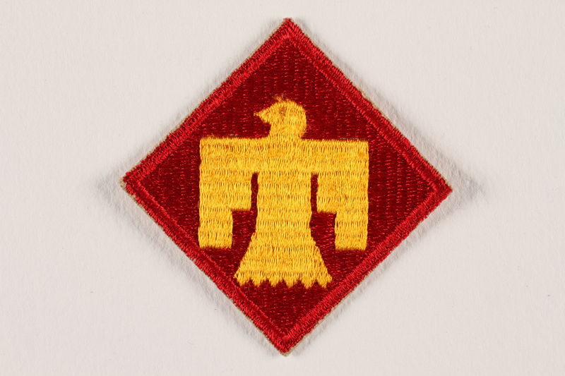 2004.749.28 front US Army 45th Infantry Division shoulder sleeve patch with a gold Thunderbird on a red field