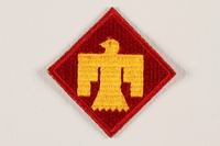 2004.749.28 front US Army 45th Infantry Division shoulder sleeve patch with a gold Thunderbird on a red field  Click to enlarge