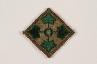 2004.749.29 front US Army 4th Infantry Division shoulder sleeve patch with 4 green ivy leaves on a brown field  Click to enlarge