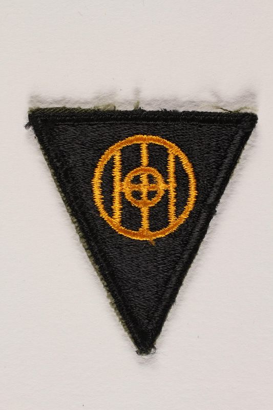 2004.749.32 front US Army 83rd Infantry Division shoulder sleeve patch with a yellow monogram of Ohio