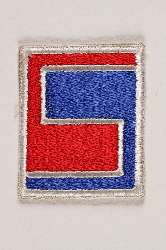 2004.749.33 front US Army 69th Infantry Division shoulder sleeve patch with a stylized red and blue 69