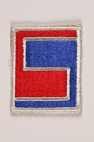 2004.749.33 front US Army 69th Infantry Division shoulder sleeve patch with a stylized red and blue 69  Click to enlarge