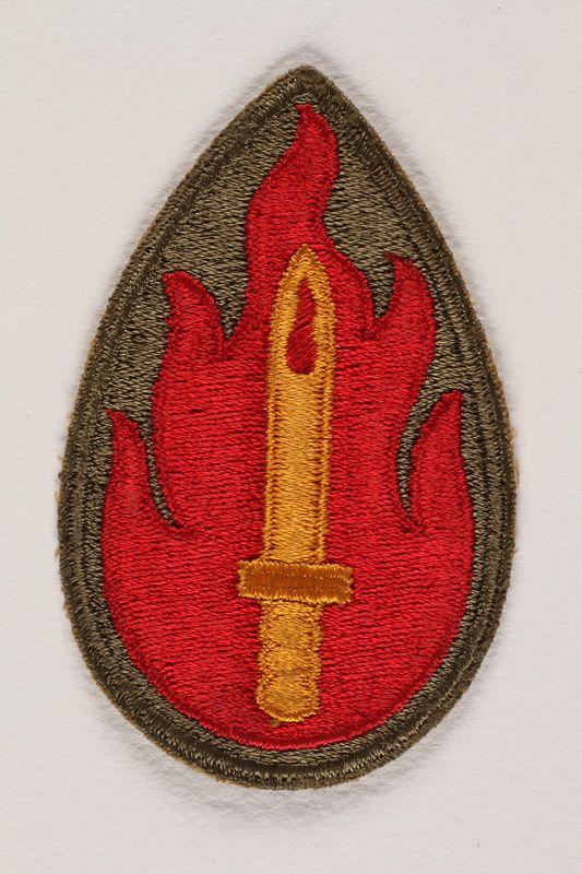 2004.749.34 front US Army 63rd Infantry Division shoulder sleeve patch with a golden sword within a red flame