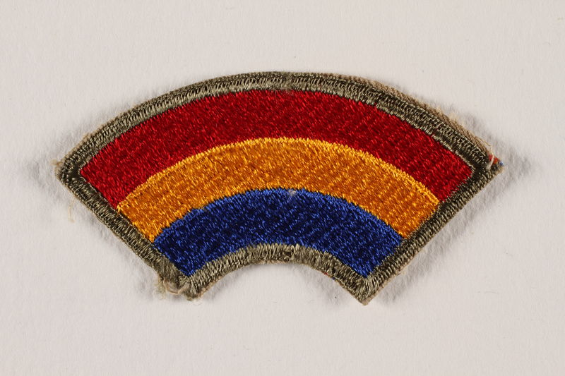 2004.749.35 front US Army 42nd Infantry Division shoulder sleeve patch with a red, yellow and blue rainbow
