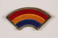2004.749.35 front US Army 42nd Infantry Division shoulder sleeve patch with a red, yellow and blue rainbow  Click to enlarge