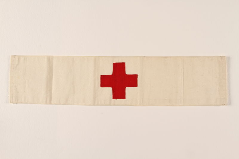 2008.346.1 front Armband handstitched with a red cross and Star of David by a concentration camp inmate and nurse
