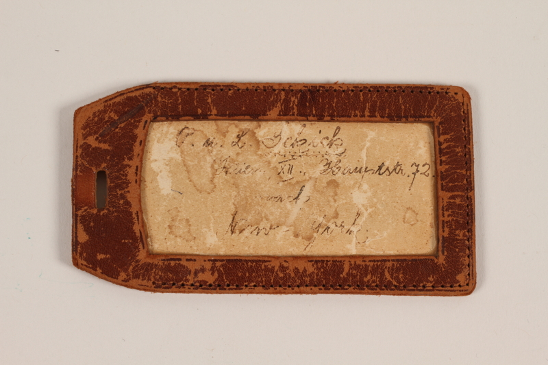 2007.488.2 front Leather luggage tag used by an Austrian Jewish refugee