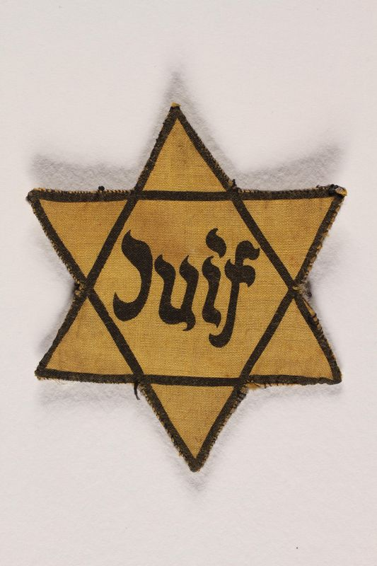 2008.65.2 front Star of David patch with Juif worn by Jewish woman