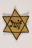2008.65.2 front Star of David patch with Juif worn by Jewish woman  Click to enlarge