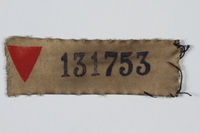 1999.100.39 front Prisoner patch with red triangle and number owned by a German Jewish displaced person and camp survivor  Click to enlarge