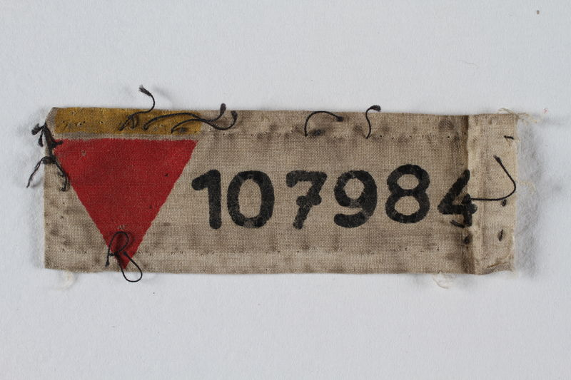 1999.100.40 front Prisoner patch with red triangle and number issued to a German Jewish prisoner