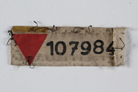 1999.100.40 front Prisoner patch with red triangle and number issued to a German Jewish prisoner  Click to enlarge