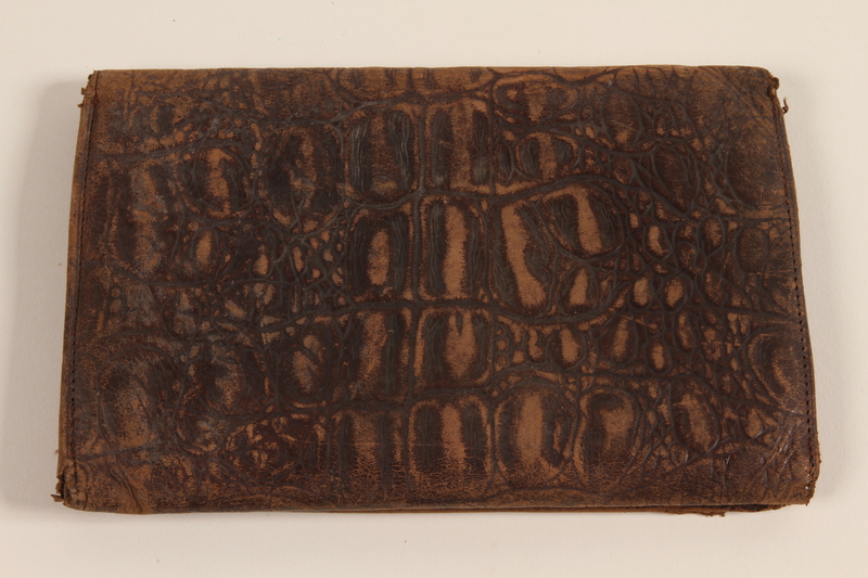 2007.492.2 front Embossed brown leather bi-fold wallet used by a soldier in the Jewish Brigade, British Army