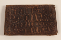 2007.492.2 front Embossed brown leather bi-fold wallet used by a soldier in the Jewish Brigade, British Army  Click to enlarge