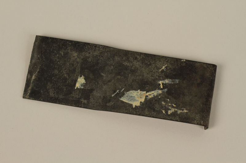 2007.492.3 front Bent metal shard saved by a soldier in the Jewish Brigade, British Army