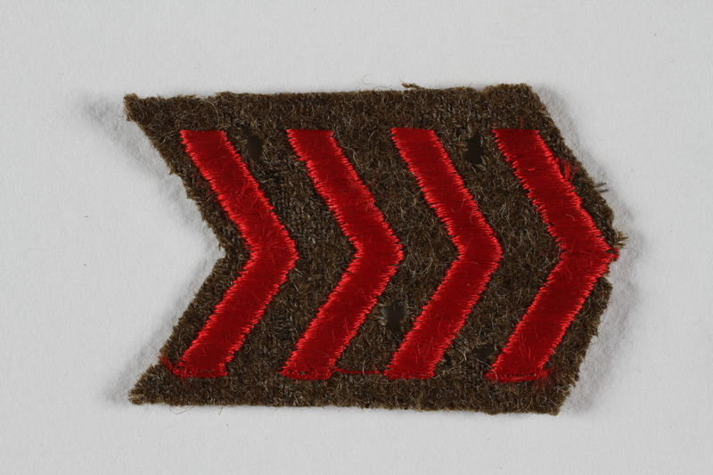 2007.492.6 front Jewish Brigade Group arm patch with 4 red chevrons worn by a soldier in the Brigade
