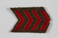 2007.492.6 front Jewish Brigade Group arm patch with 4 red chevrons worn by a soldier in the Brigade  Click to enlarge