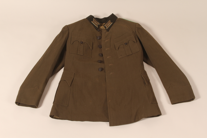 2007.494.2 a front Bulgarian WWI officer's uniform hat, jacket, and pants worn during service in a forced labor brigade