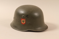 1990.297.2 right side Schutzpolizei [Security police] helmet taken from a captured German by a US soldier  Click to enlarge