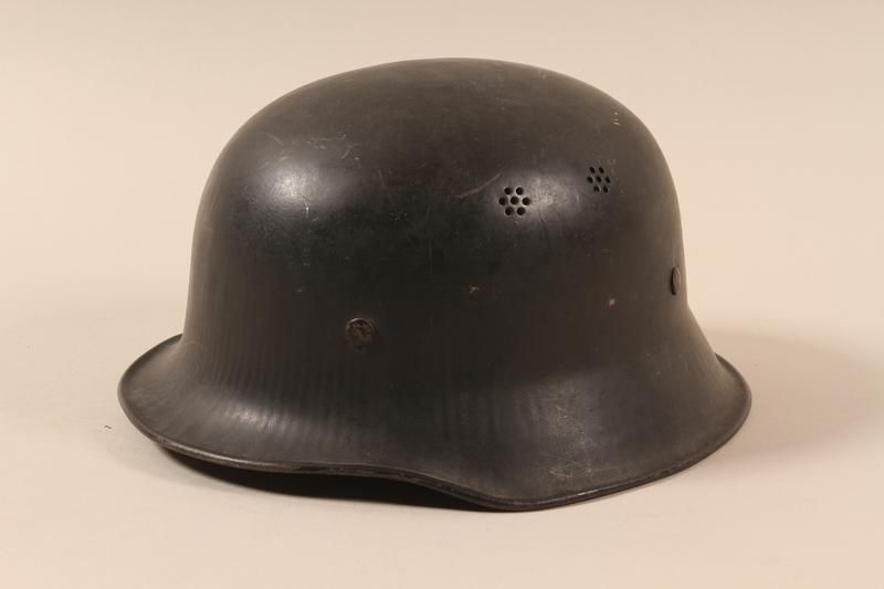 1990.297.3 left side Helmet taken from a captured German by a US soldier