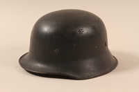 1990.297.3 left side Helmet taken from a captured German by a US soldier  Click to enlarge