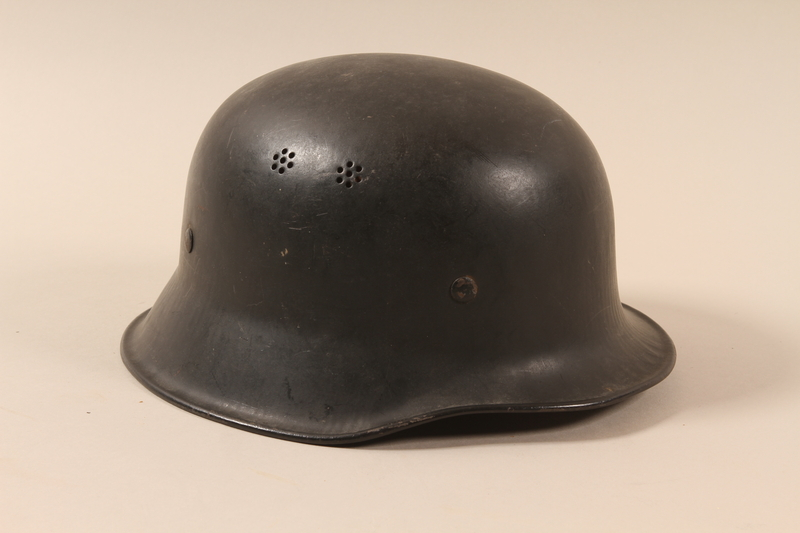 1990.297.3 right side Helmet taken from a captured German by a US soldier