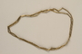 Gold link chain necklace received by a refugee in a displaced persons camp upon the birth of her daughter