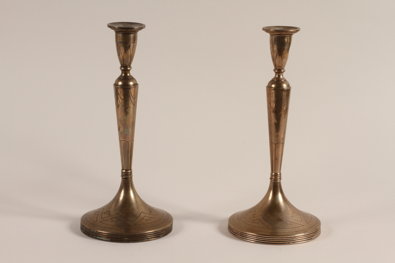 2008.328.1 a-b front Pair of silver candlesticks with floral engraving recovered in postwar Germany