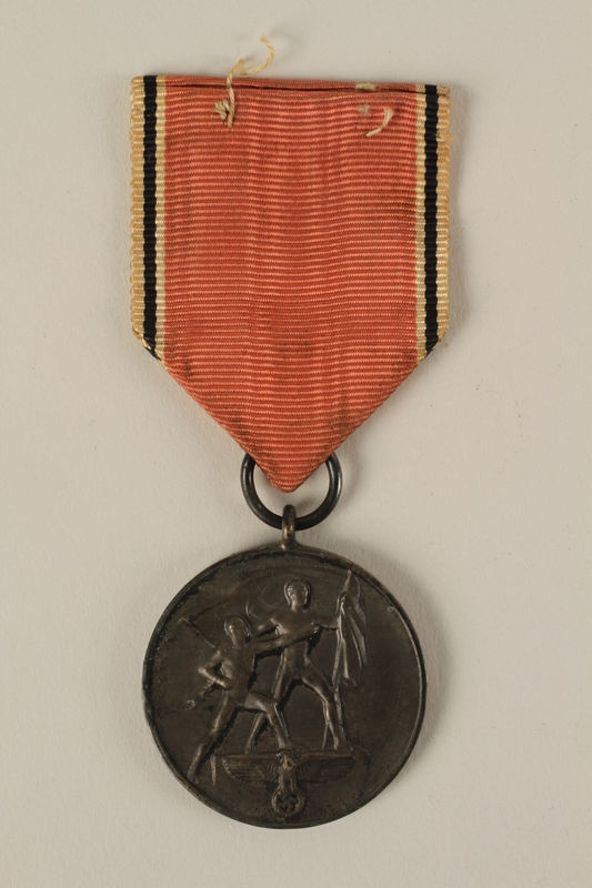 2008.201.2 front Medal and ribbon commemorating the 1938 Anschluss of Austria