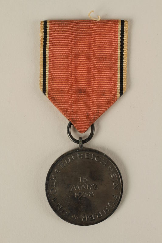 2008.201.2 back Medal and ribbon commemorating the 1938 Anschluss of Austria