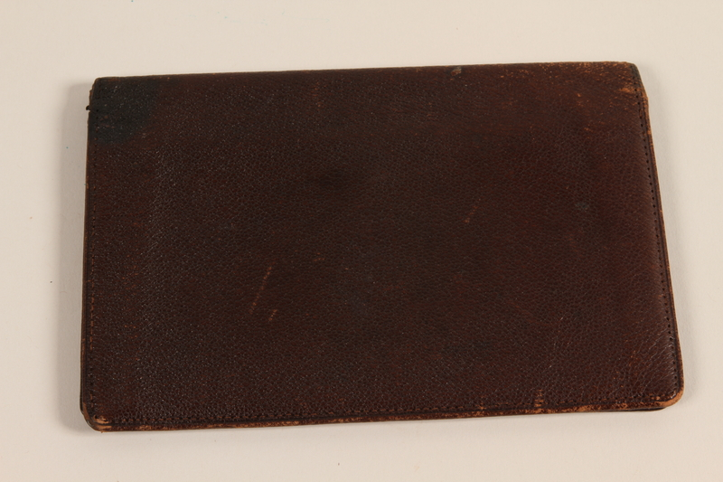 2008.204.3 closed Brown leather billfold brought with a German Jewish prewar refugee
