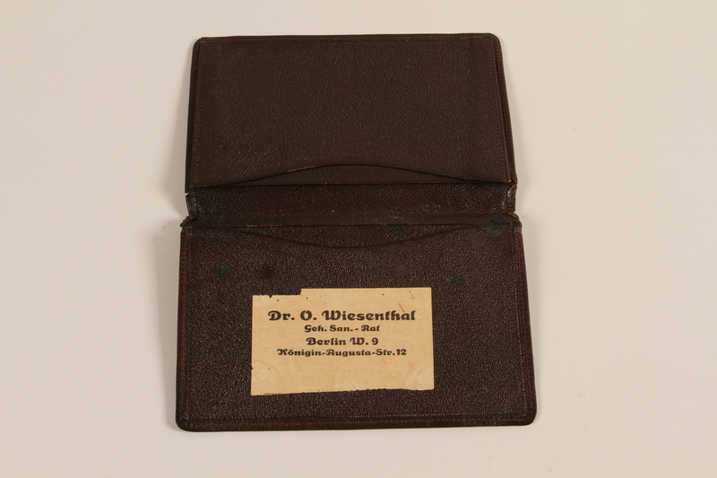 2008.204.3 open Brown leather billfold brought with a German Jewish prewar refugee