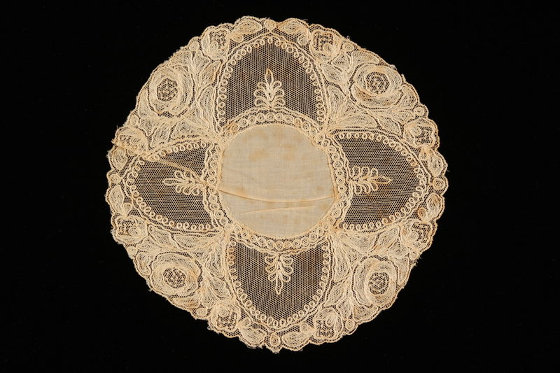 2008.220.2 front Lace doily with net semi-circles and floral design recovered by Dutch Jewish family