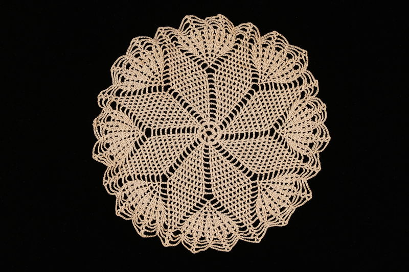 2008.220.4 front Flower patterned crocheted doily made by a Dutch Jewish woman after the war