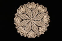 2008.220.4 front Flower patterned crocheted doily made by a Dutch Jewish woman after the war  Click to enlarge