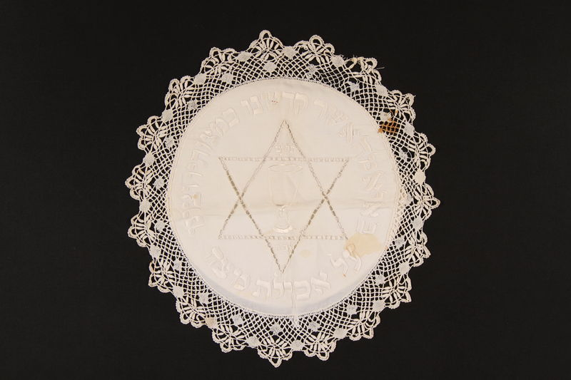 2008.220.5 front Matzoh cover with an embroidered Star of David, kiddush cup, and Hebrew inscription recovered postwar by a Dutch Jewish family