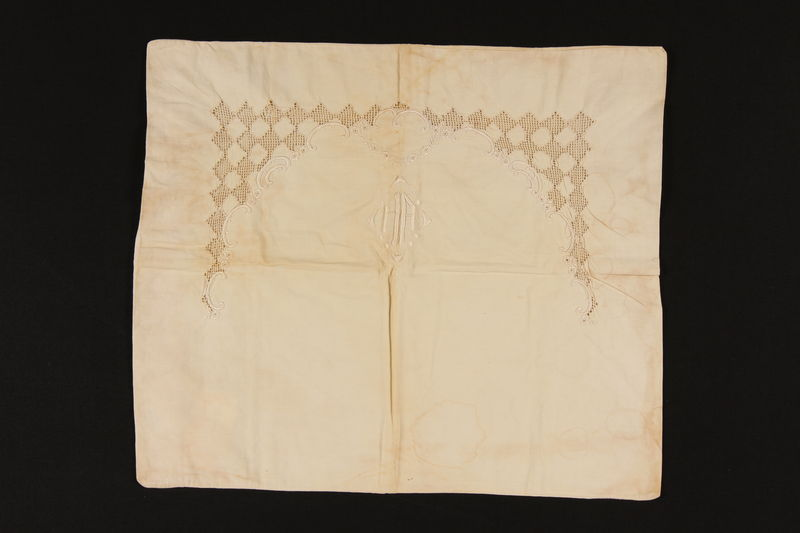 2008.222.2 front Embroidered white pillowcase used in hiding in Poland