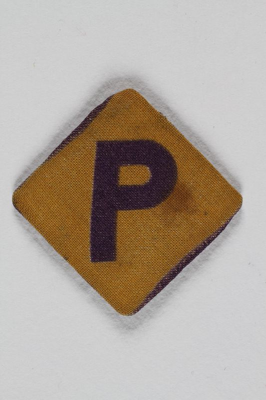 2008.227.2 front Forced labor badge, yellow with a purple P, worn by a Polish Jewish woman in hiding as a Catholic