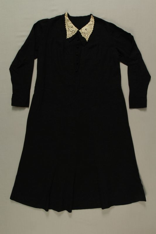 2008.227.4 front Long sleeved black dress saved by a neighbor and recovered postwar