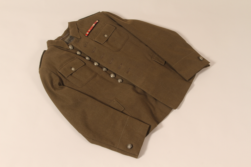2009.116.1 a front Polish Army uniform jacket and pants worn after the war by a former Jewish partisan