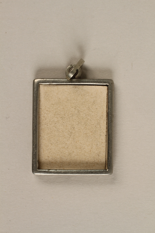 2006.363.4 front Miniature metal picture frame pendant made in Theresienstadt concentration camp