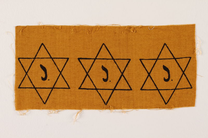 2007.14.2 front Sheet of three uncut, factory-printed Star of David badges printed with a J acquired by a Belgian Catholic rescuer