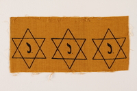 2007.14.2 front Sheet of three uncut, factory-printed Star of David badges printed with a J acquired by a Belgian Catholic rescuer  Click to enlarge