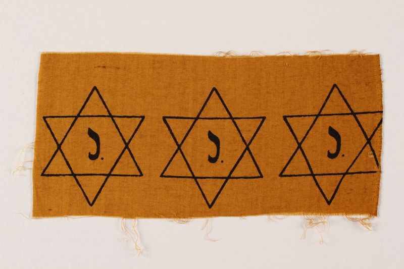 2007.14.3 front Sheet of three uncut, factory-printed Star of David badges printed with a J acquired by a Belgian Catholic rescuer