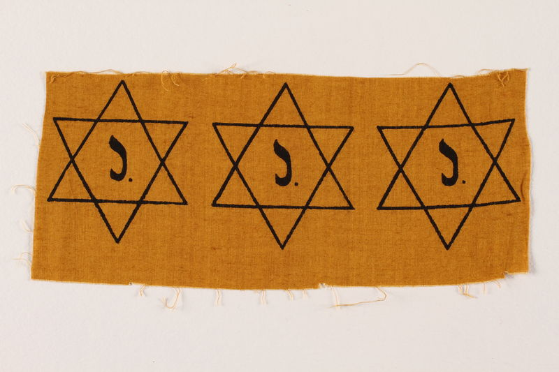 2007.14.4 front Sheet of three uncut, factory-printed Star of David badges printed with a J acquired by a Belgian Catholic rescuer
